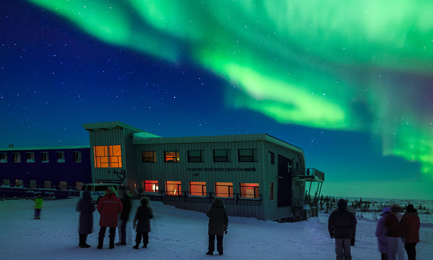 The Churchill Northern Studies Centre, a Canadian subartic research station, with northern lights (aurora borealis) lighting up the sky