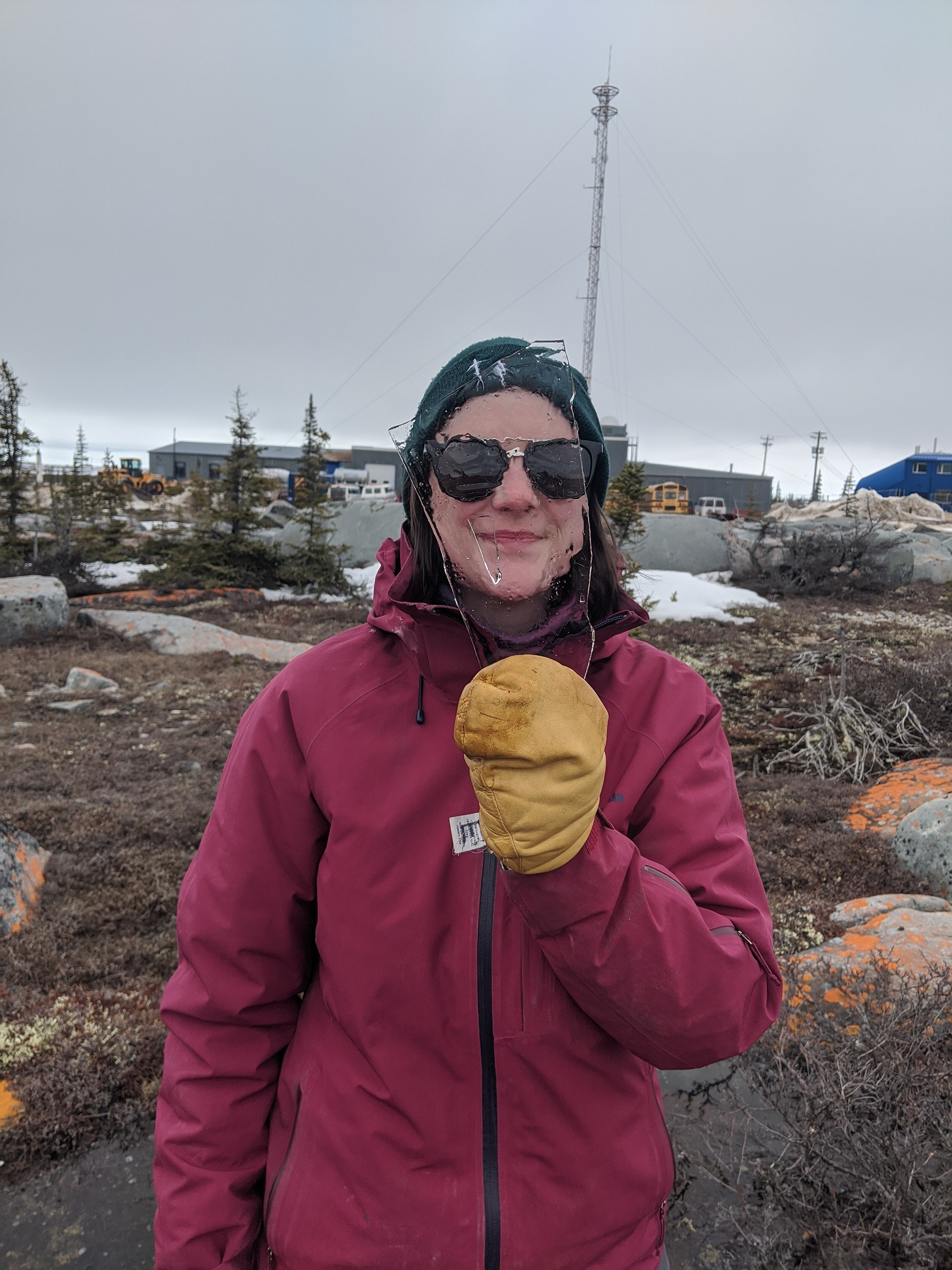 Erica holding a piece of ice from a tundra pond